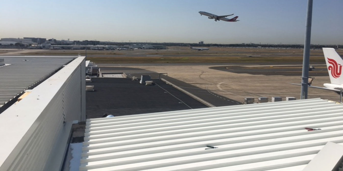 Metal Roof Contracting - McDonalds - Sydney International Airport - Quikdeck are in the finishing stages of a new roof construction of a McDonalds Restaurant adjacent t