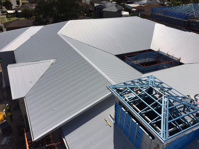 This large commercial roofing project consists of 6,000 sq/m of custom orb metal roof sheeting, half round gutters, downpipes and associated roofing materials.