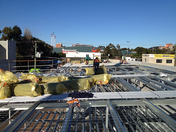 Quikdeck Roofing Services Current Major Projects Project - Kennards Self Storage, Wollongong - ../../dc/gallery/lrg/4KSSRoof.jpg