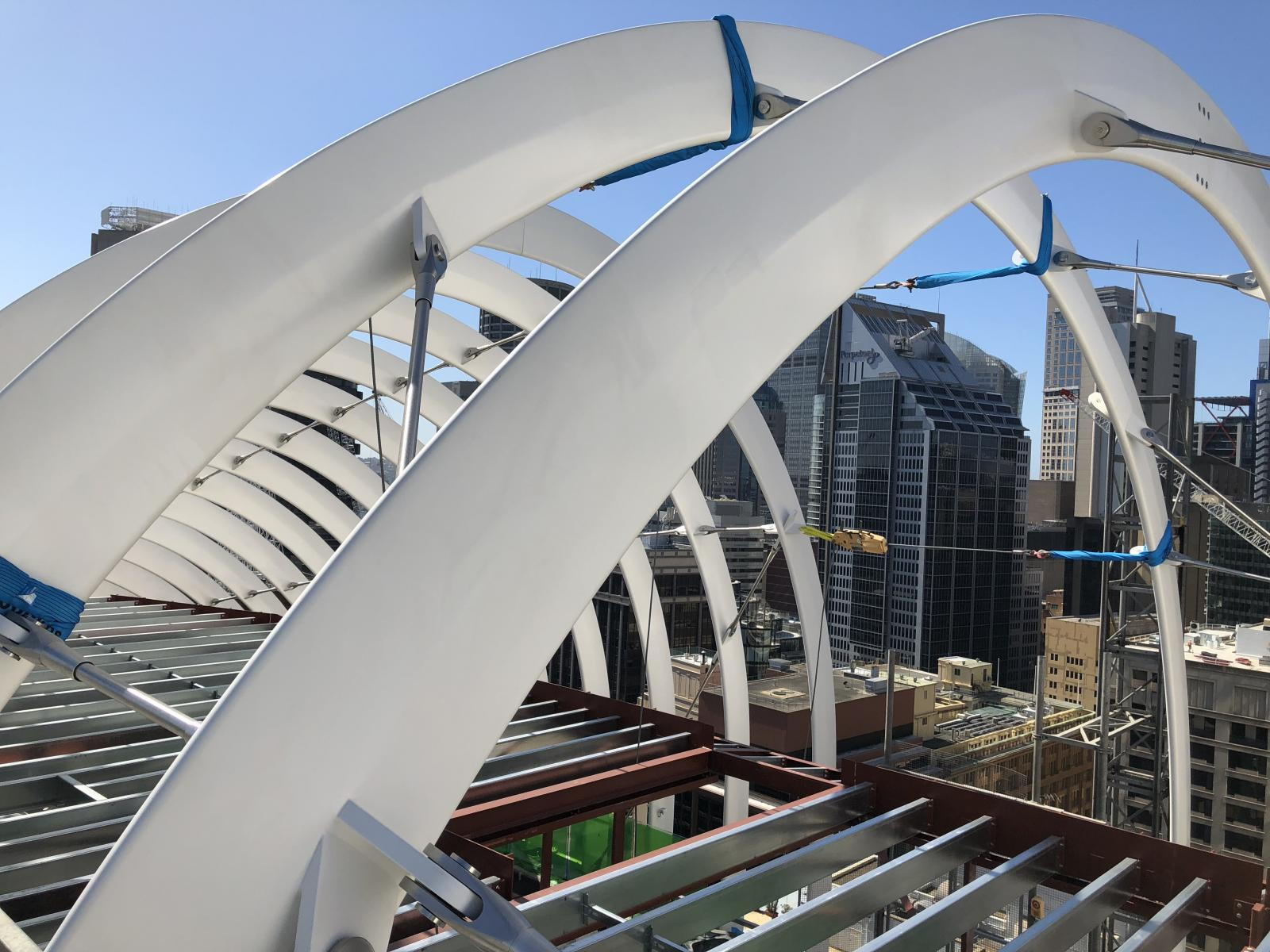This architectural metal roof design for Arc by Crown Group is inspired by Sydney Harbour Bridge and Opera House