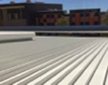 Close up view of metal roofing sheets on commercial premises roof